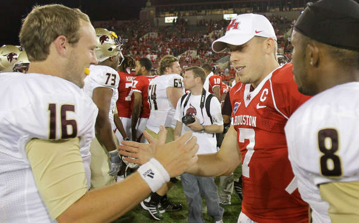 Texas State quarterback Bryan Hill (16), left, congratulates Houston quarterback Case Keenum (7) after the game.