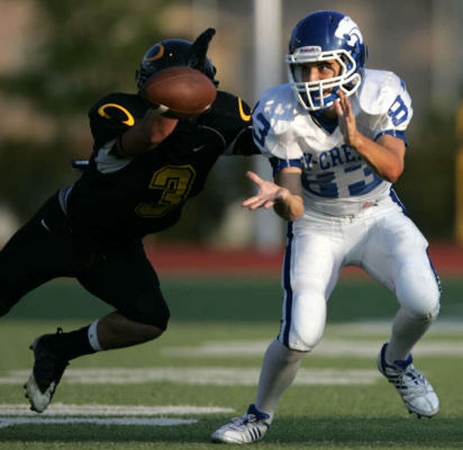 Klein Oaks's Dillon May (3) deflects a pass intended for Cy-Creek's Robert Walter. Photo: ERIC CHRISTIAN SMITH, FOR THE CHRONICLE