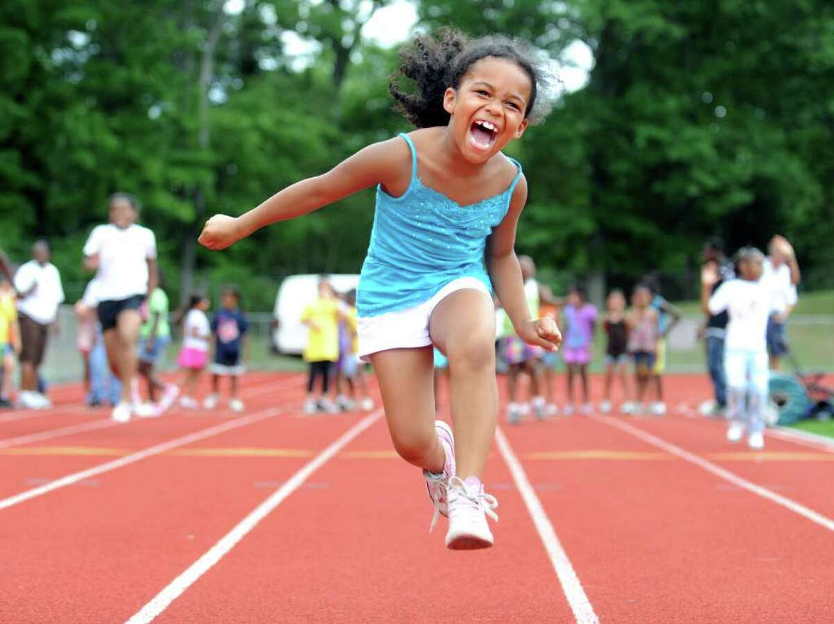 Seven-year-old Rosie Marshall, of Norwalk, lunges for the finish line during the Chelsea Cohen Fitness Academy's 1st Annual Jamboree Wednesday, August 3, 2011 at Norwalk Highís Testa Field.