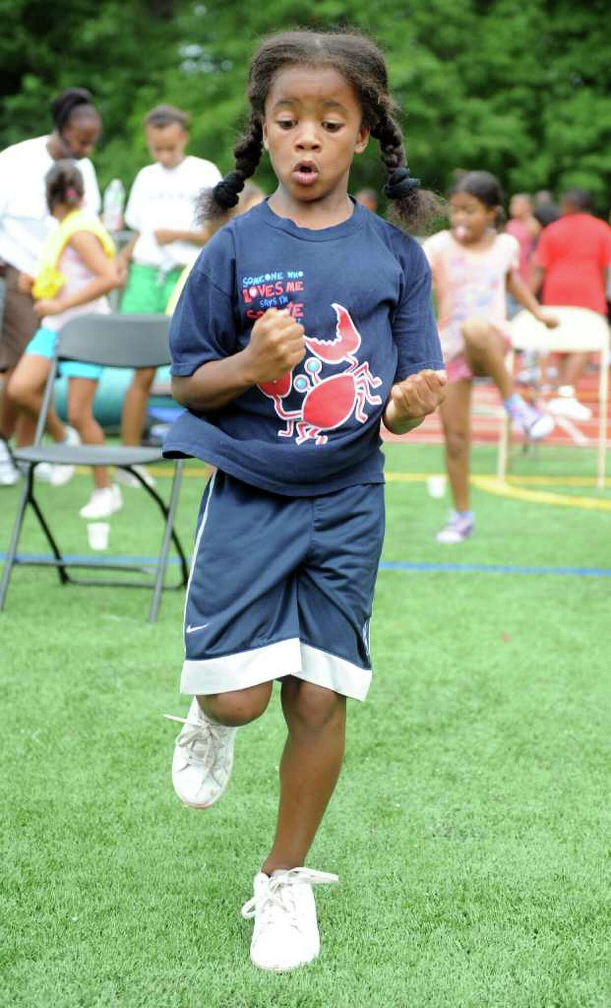 Nine-year-old Carsyn Langhorn, of Norwalk, jogs in place during the Chelsea Cohen Fitness Academy's 1st Annual Jamboree Wednesday, August 3, 2011 at Norwalk Highís Testa Field.