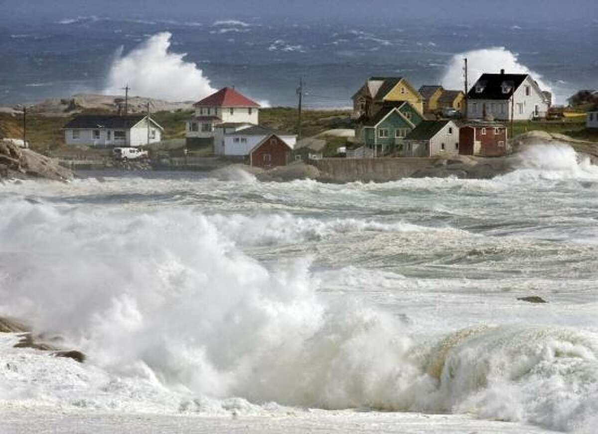 Waves from hurricane Earl pound the coast at Peggys Cove, Nova Scotia, Saturday, Sept. 4, 2010. Police closed roads leading to the iconic lighthouse as a safety precaution, keeping the curious away from the dangerous rocks. Heavy rain, high winds and surf battered the region.