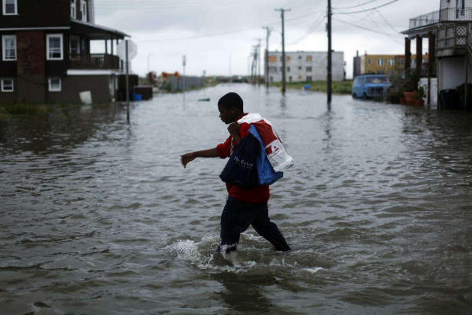 Ibn McKinney, 14, walks through a flooded street in Atlantic City, N.J., as Hurricane Earl moves up the eastern coast, Friday, Sept. 3, 2010. Photo: Matt Rourke, AP