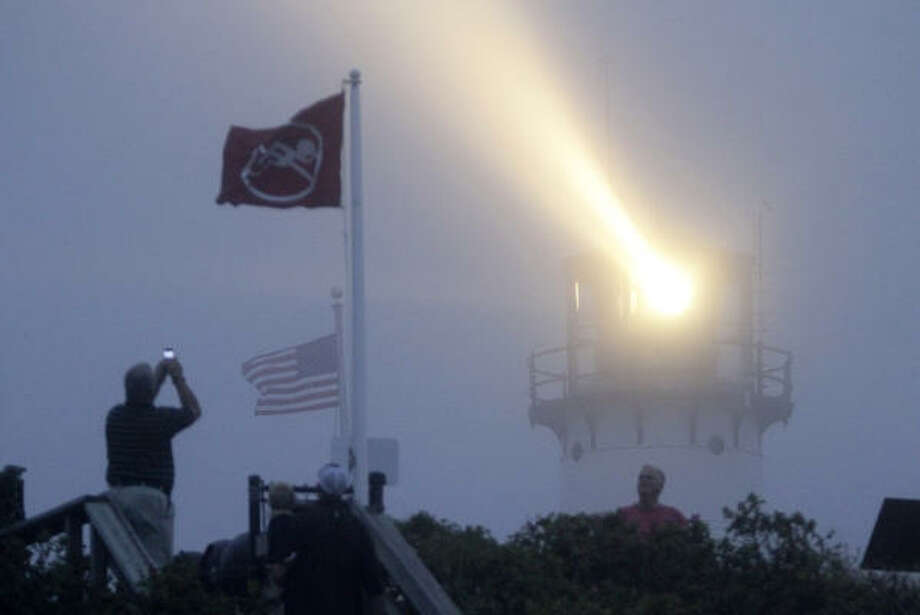 The Chatham Lighthouse, situated at a working U.S. Coast Guard Station, casts its beam into a foggy evening, in Chatham, Mass., on Cape Cod, Friday, Sept. 3, 2010. Hurricane Earl is expected to arrive at Cape Cod late Friday. Photo: Steven Senne, AP
