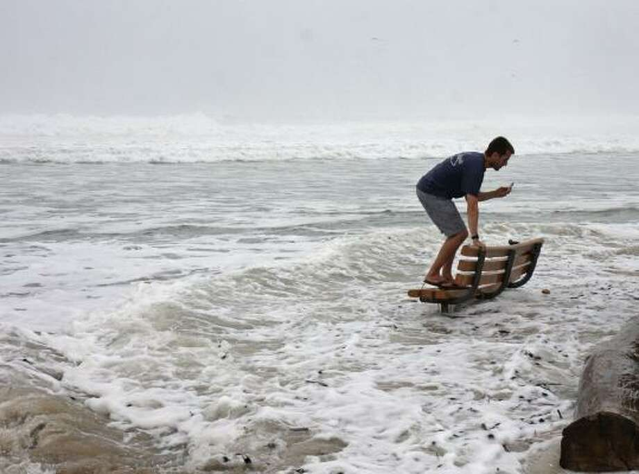 A man who was taking pictures at Ditch Plains beach gets startled by a wave in Montauk, N.Y., Friday, Sept. 3, 2010.  Hurricane Earl stirred up the Atlantic Ocean as it moved up the east coast. Photo: Gregory Payan, AP