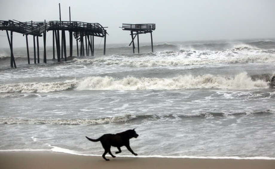 The damaged Frisco pier still stands on Friday, Sept. 3, 2010 after taking a beating from Hurricane Earl. Photo: Steve Earley, AP