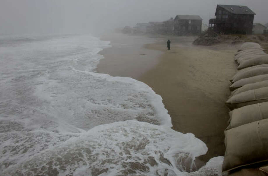 Sea levels remain high throughout the morning Friday, Sept, 3, 2010 as Hurricane Earl lingers offshore of Nags Head, N.C. Photo: Stephen M. Katz, AP