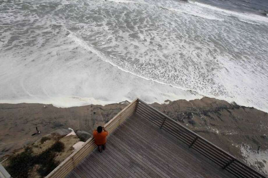 High tide moves close to a hotel deck as  Nags Head, N.C., Thursday, Sept. 2, 2010 as Hurricane Earl moves closer to North Carolina's Outer Banks. Photo: Gerry Broome, AP