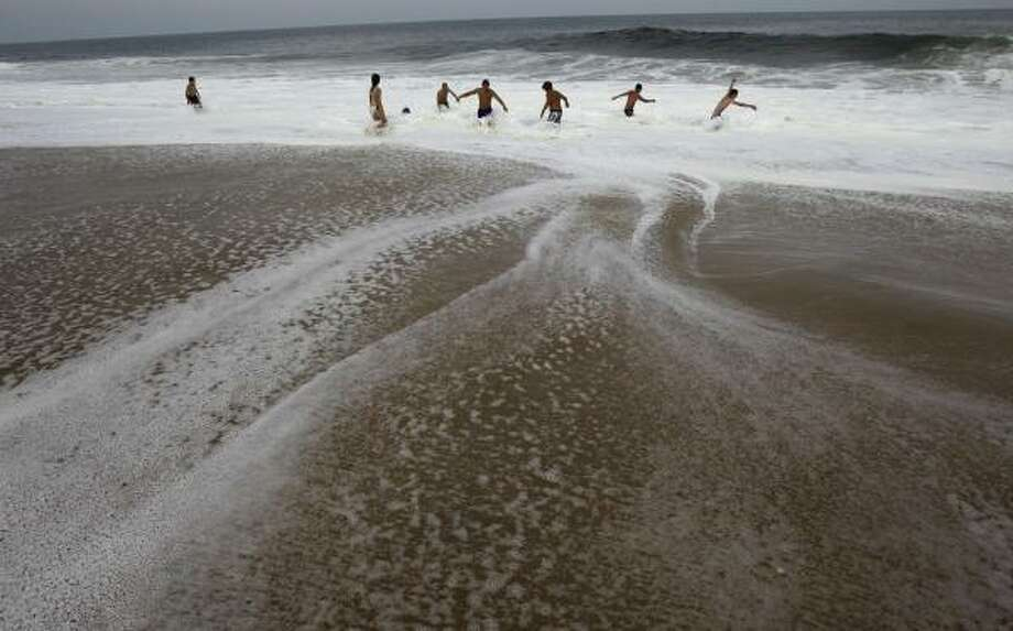 People play in the surf as Hurricane Earl heads toward the eastern coast, Thursday, Sept. 2, 2010, in Ocean City, Md. Photo: Rob Carr, AP