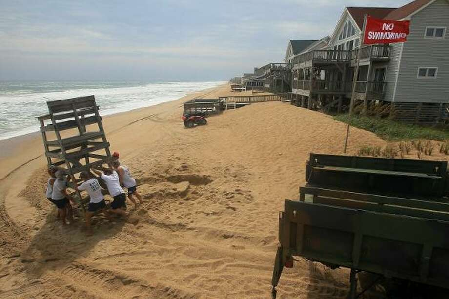 Life guards remove a stand from the beach in preparation for the approaching Hurricane Earl September 2, 2010 in Kitty Hawk, North Carolina. A mandatory evacuation notice has been issued for Dare County as Hurricane Earl, which is expected to pass the Outer Banks of North Carolina late Thursday night into Friday morning, approaches. Photo: Mark Wilson, Getty Images