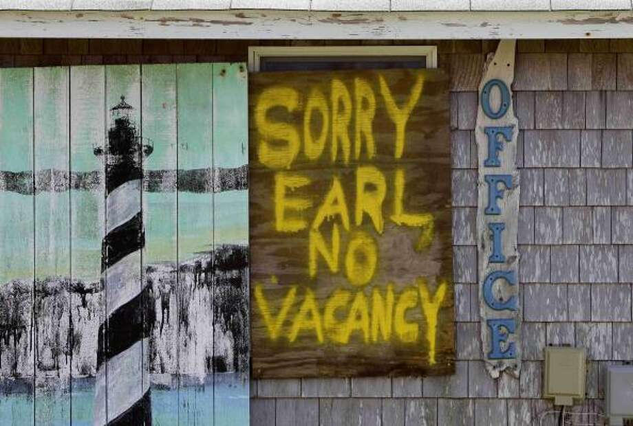 A window is boarded up with a message at the Buxton Beach Motel in Buxton, N.C., Wednesday, Sept. 1, 2010 as Hurricane Earl approaches North Carolina's Outer Banks. Photo: Gerry Broome, AP