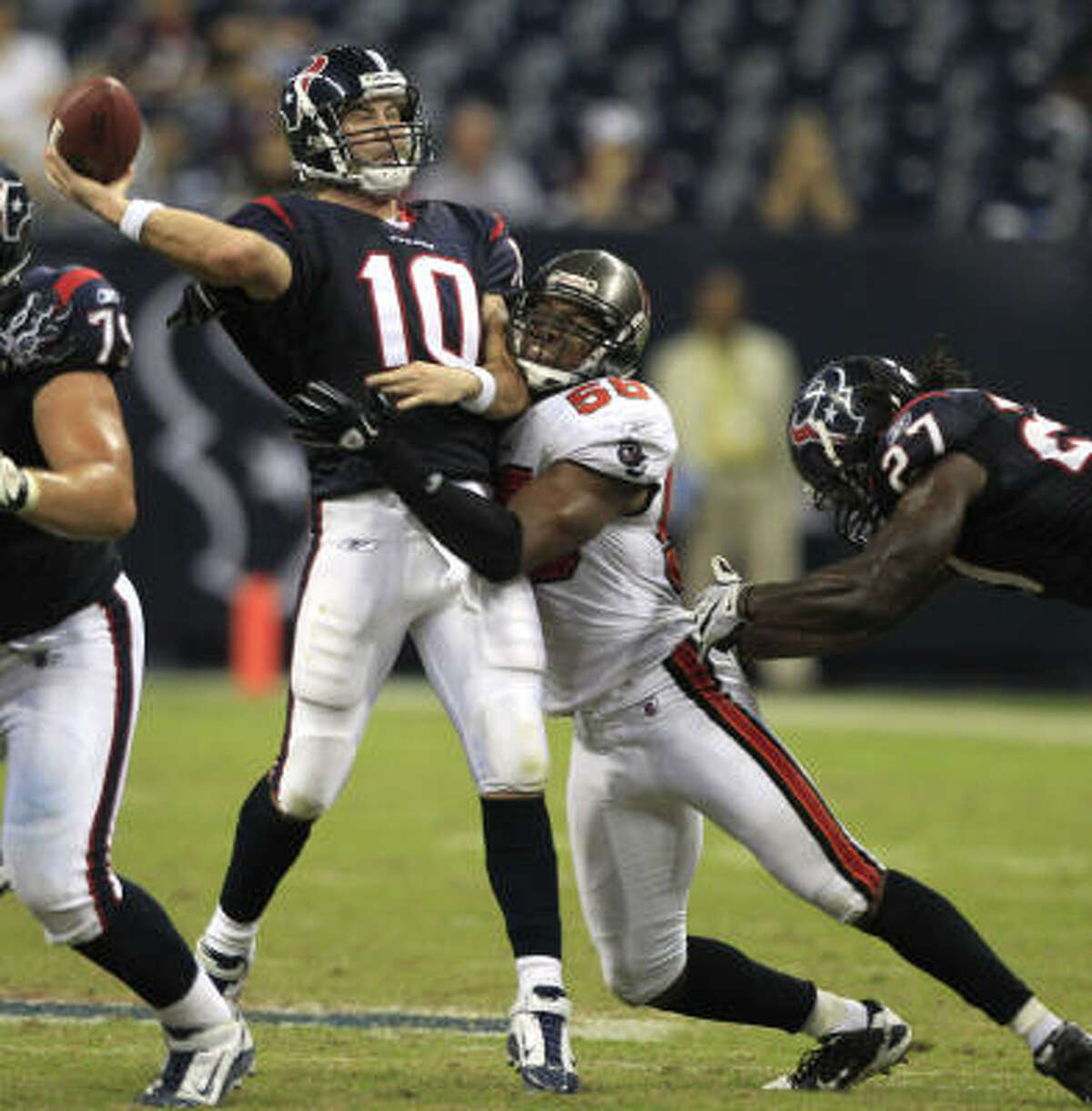 Texans quarterback John David Booty (10) is hit by Buccaneers linebacker Dekoda Watson as he attempts a pass during the fourth quarter.