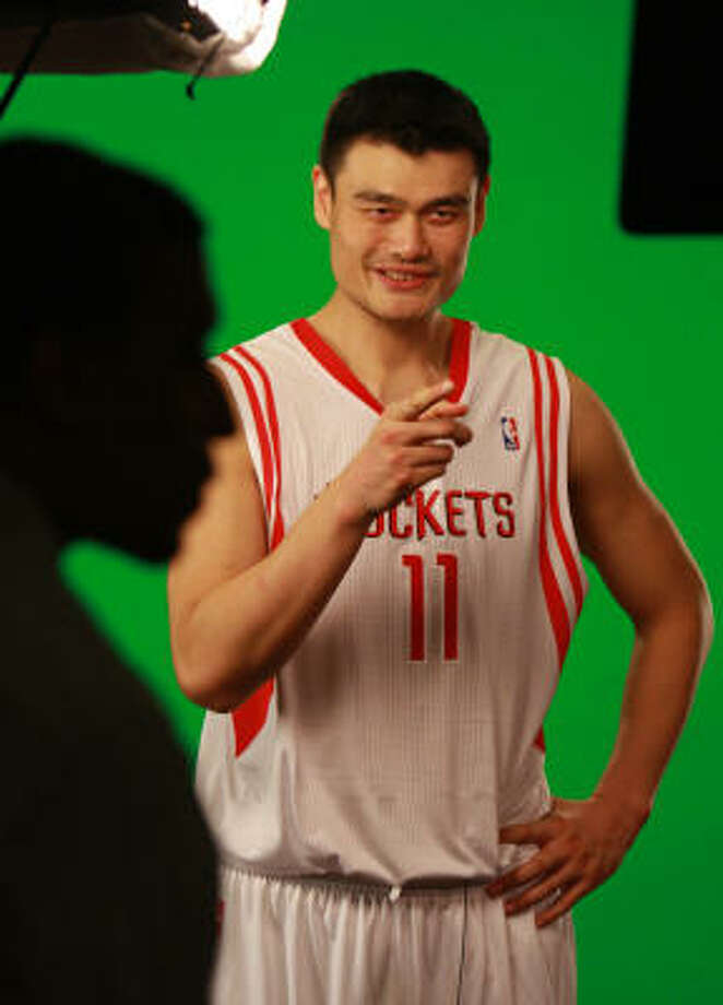 Yao Ming, shown here during a video shoot on Rockets media day, is aching to get back on the court. Photo: Gary Fountain, For The Chronicle