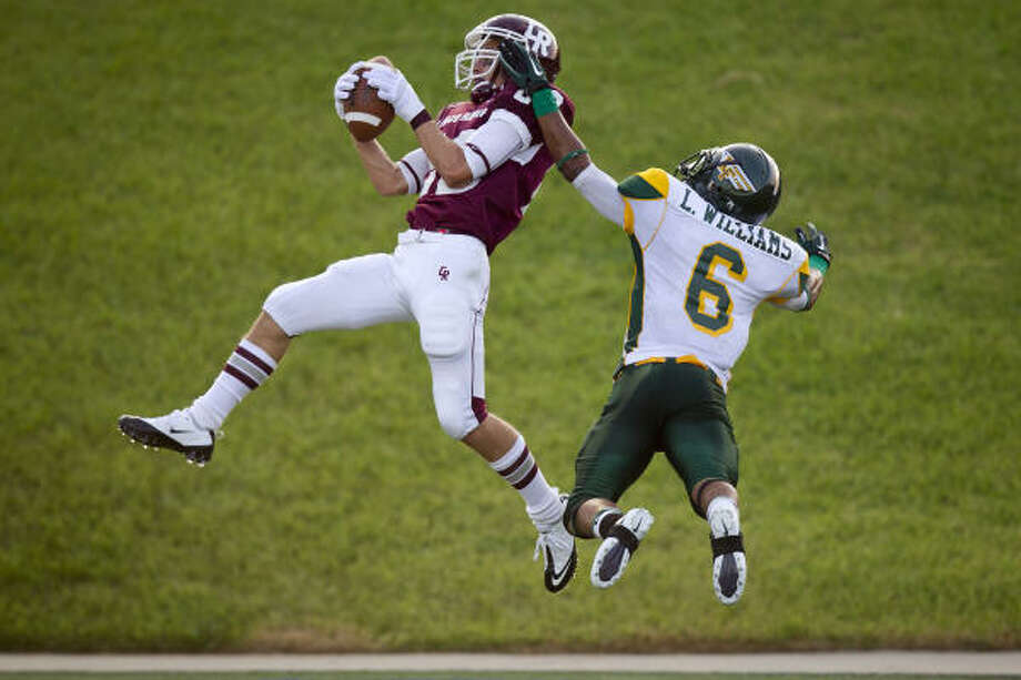 Aug. 26: Cinco Ranch 42, Klein Forest 21 Cinco Ranch receiver Alex Ludowig hauls in a touchdown catch over Klein Forest defensive back Lewis Williams in the first quarter of Thursday's game. Photo: Smiley N. Pool, Chronicle