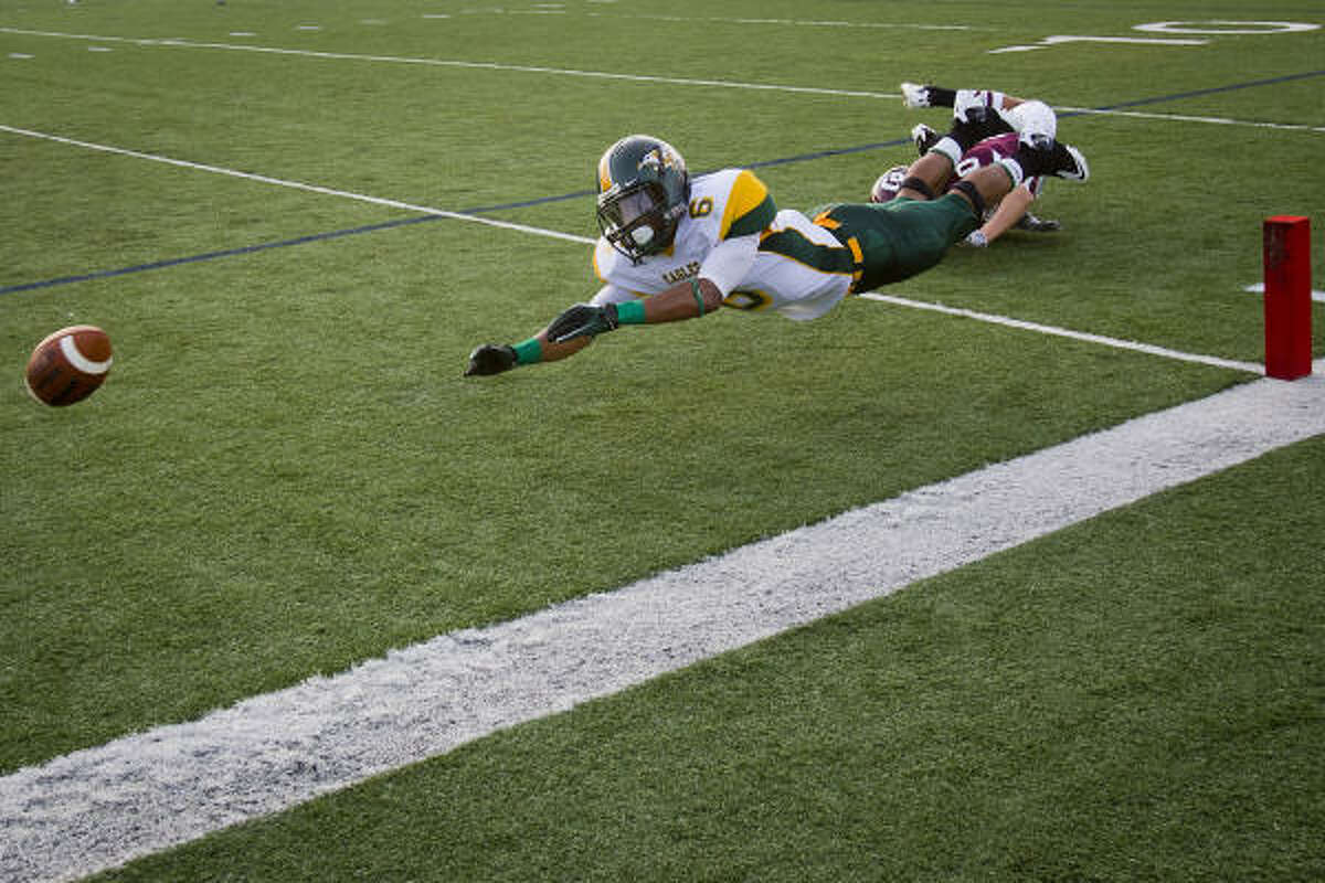 Klein Forest reciever Lewiss Williams fails to make this catch in the end zone as Cinco Ranch defensive back Cole Thomas tries to break up the play in the first quarter.