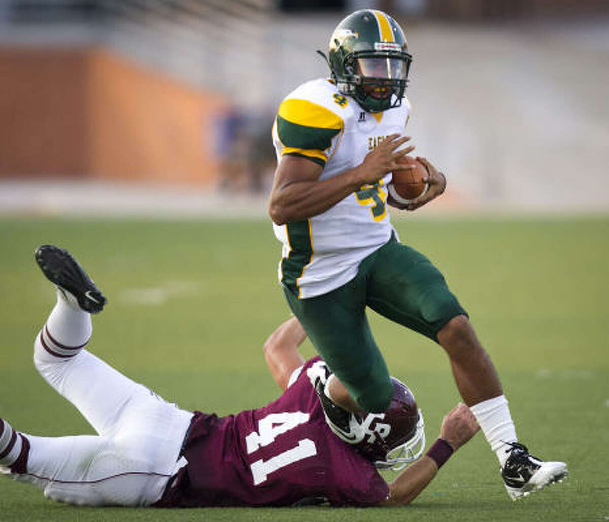 Klein Forest quarterback Matt Davis gets past Cinco Ranch linebacker Brent Johnson during the first quarter.