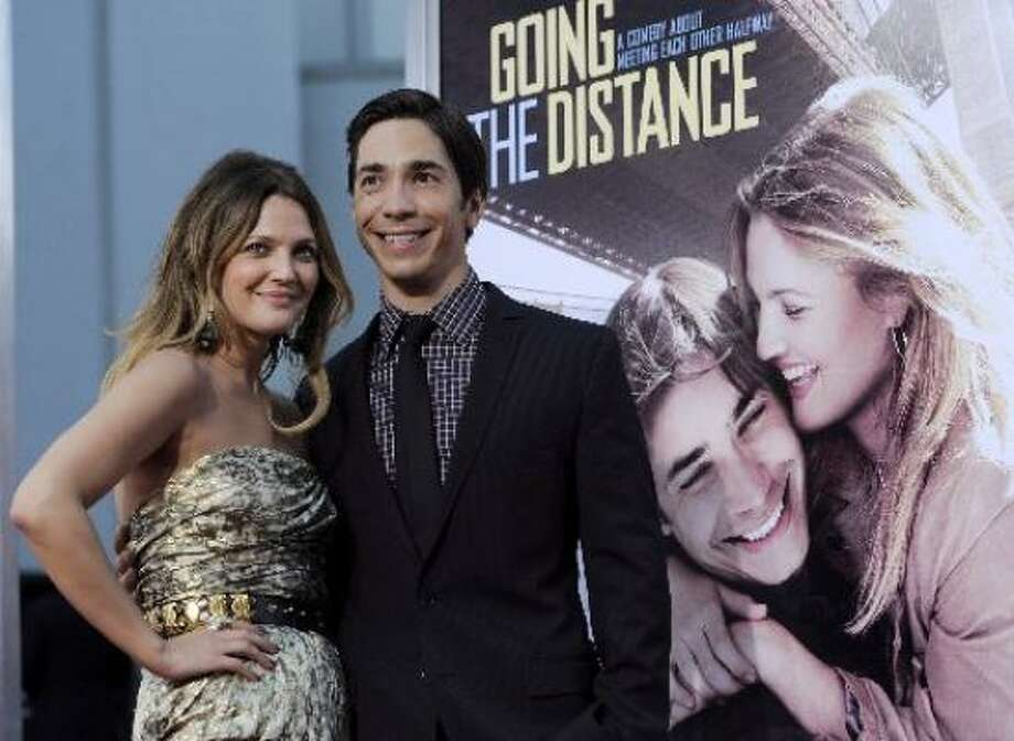 Justin Long and Drew Barrymore's on again-off again relationship is sometimes hard to keep up with. The two star in Going the Distance, a romantic comedy about a couple's long-distance relationship, which starts Sept. 3 in theaters nationwide. Photo: Getty