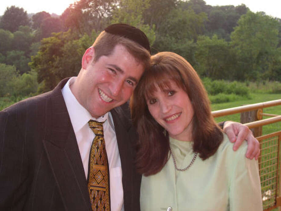 Rabbi Benzion Klatzko, seen here with his wife, Shani, is the founder of See You on Shabbos, a Web site that matches guests and hosts for weekly Shabbat dinners. Photo: RELIGION NEWS SERVICE