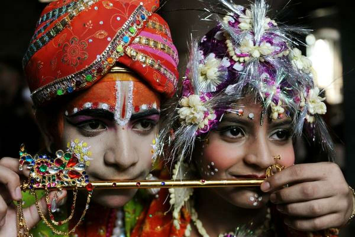 Hindus celebrate Lord Krishna's birthday with colorful decorations, costumes and dances.