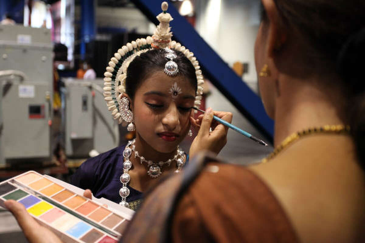 In Houston, young people perform dances narrating Krishna's life at a festival at the George R. Brown Convention Center.