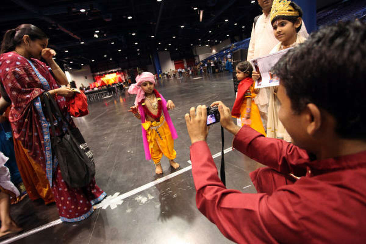 Young children, like 3-year-old Damoday Kamani, dress up for a costume competition at the annual Hindu Janmashtami event on Saturday.