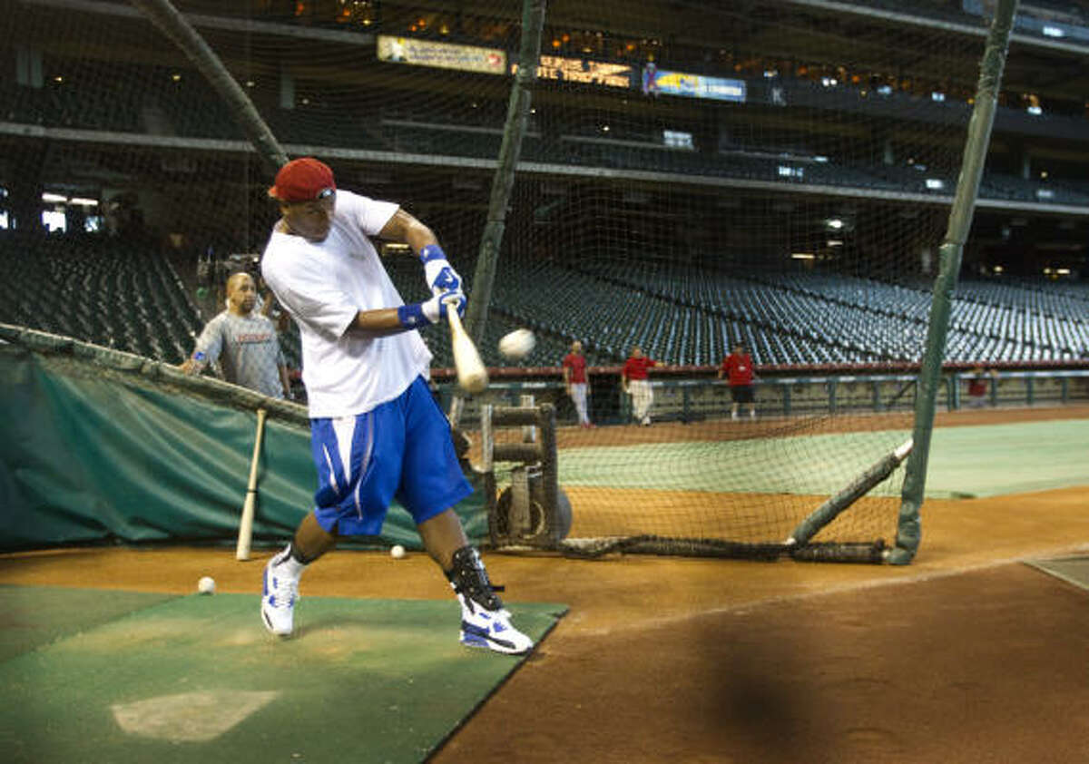 Rockets center Chuck Hayes takes a swing at the ball.