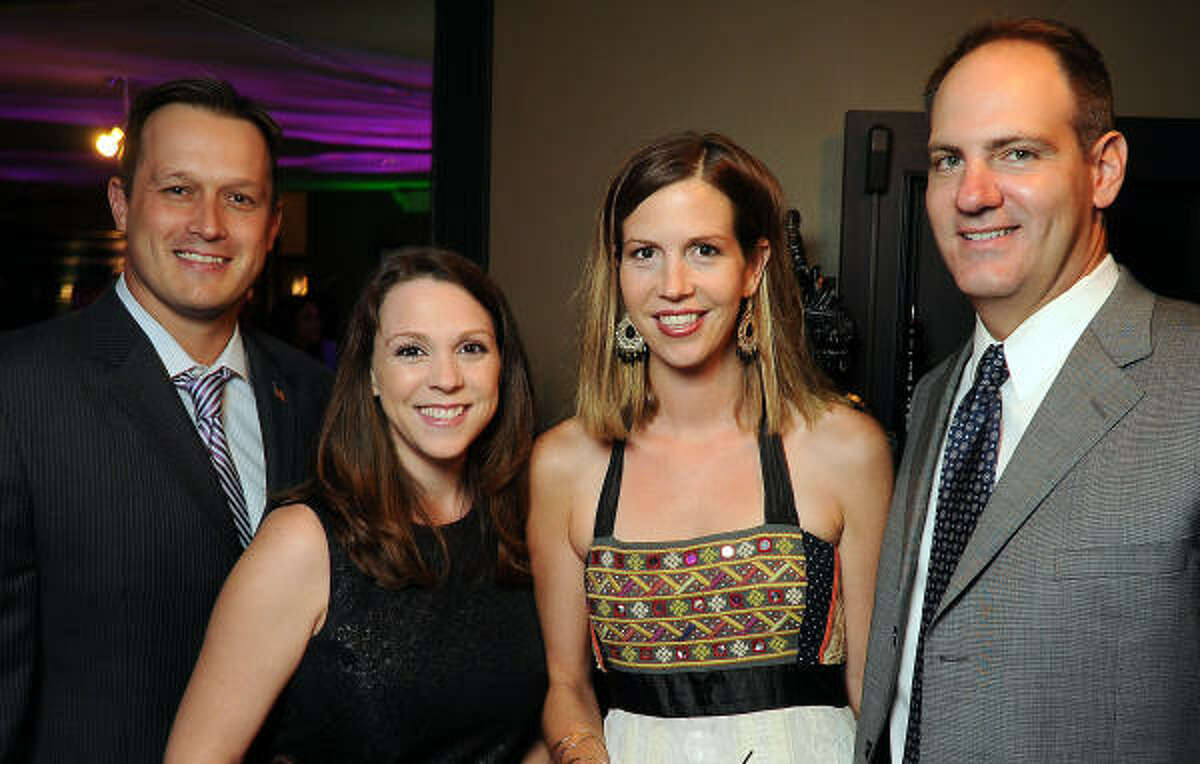 From left: Robert and Melissa Murphy with Emily and Ryan O'Shaughnessy at the Greater Houston Partnership's World Trade Soiree at Hotel ZaZa.