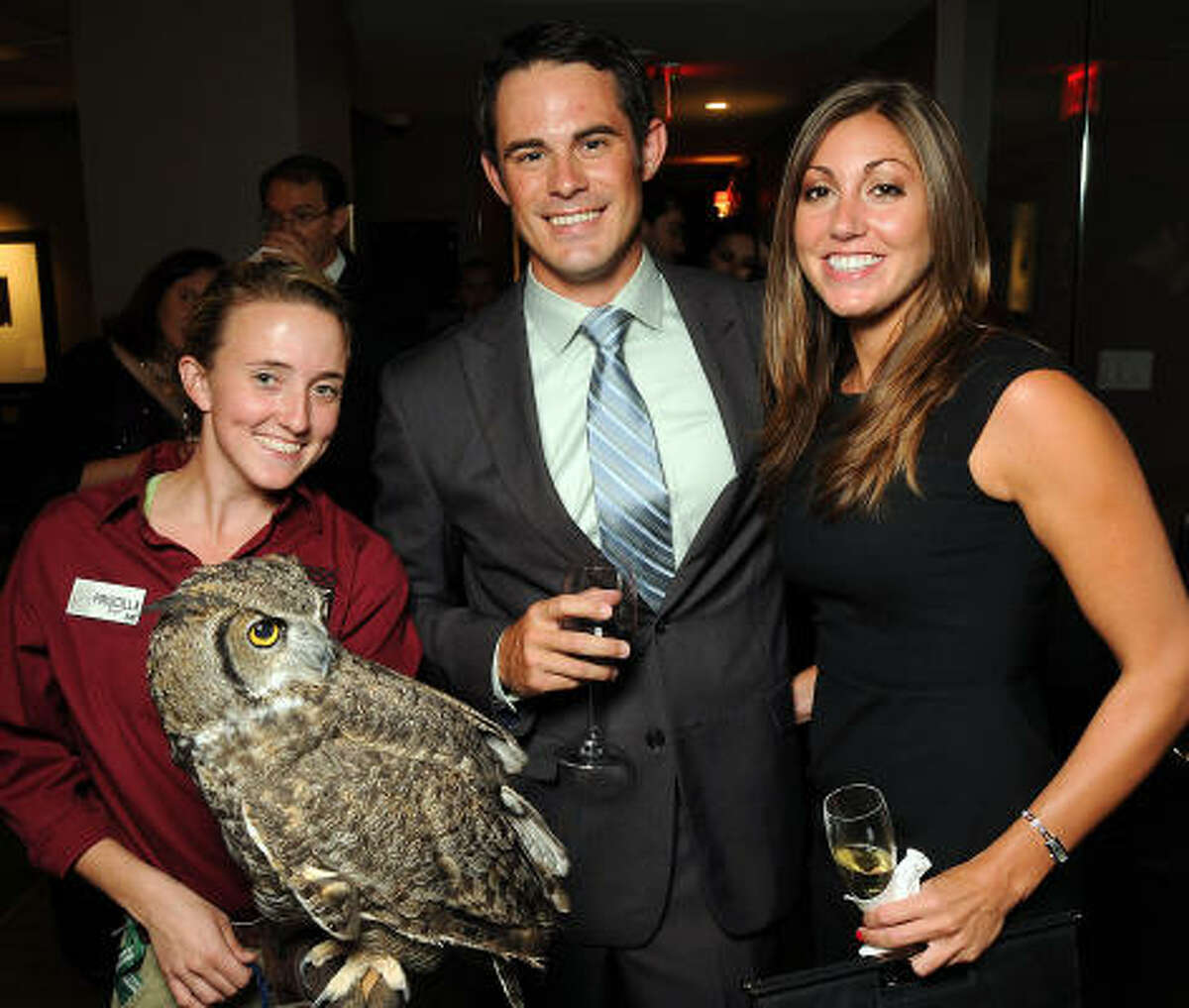The Houston Zoo's Priscilla Farley holding Ariel the great horned owl with Scott Asimakis and Rose Johnson.