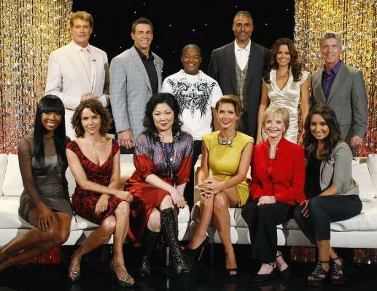 In this photo provided by ABC, the new lineup of Dancing With the Stars stars, from left, Brandy, David Hasselhoff, Jennifer Grey, Kurt Warner, Margaret Cho, Kyle Massey, Audrina Patridge, Rick Fox, Florence Henderson, co-host Brooke Burke, Bristol Palin, and host Tom Bergeron.