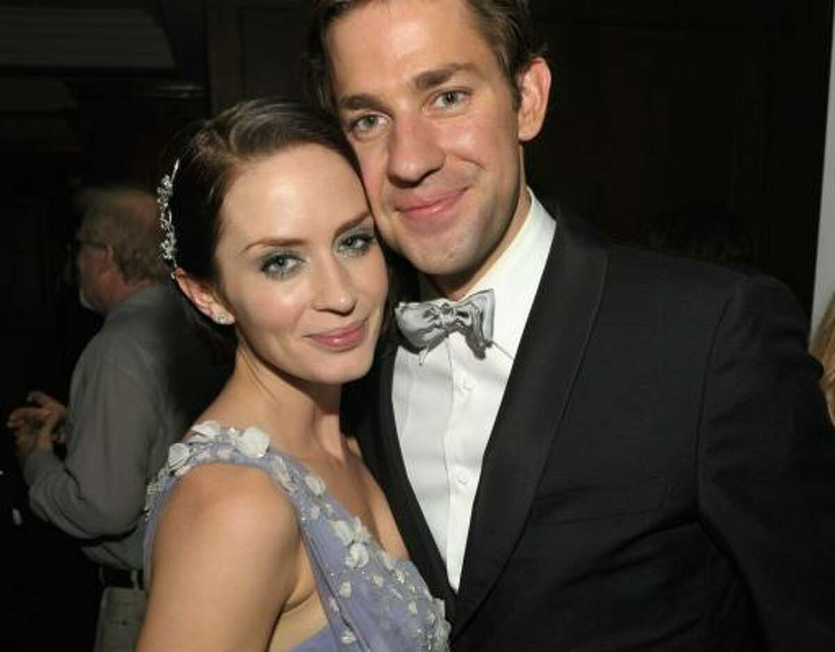 Actress Emily Blunt, with actor John Krasinski, had odd things on the front of her dress.