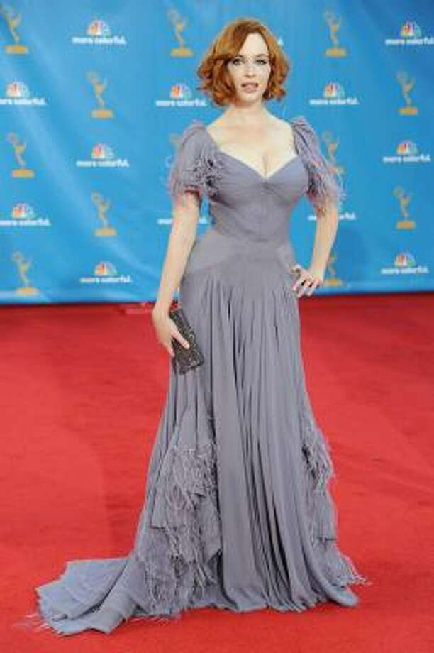 Christina Hendricks – Zac Posen feathers, maybe. But that drab color's for the birds. Photo: Frazer Harrison, Getty Images