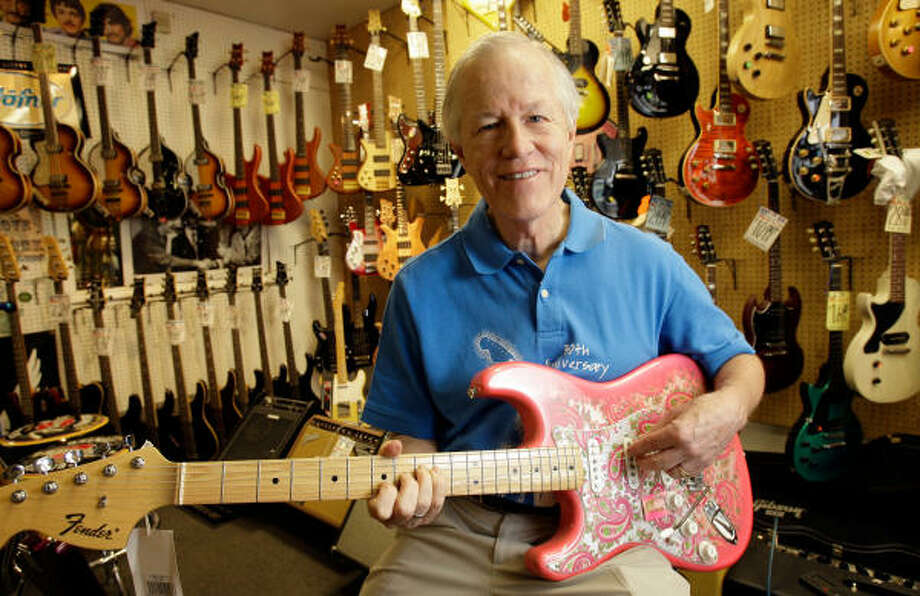 Jim Duncan, with a Fender Custom Shop Pink Paisley Stratocaster, has almost 1,000 lefthanded guitars in-house at his Southpaw Guitars on Bellaire. The Internet has enabled his 30-year-old business to reach lefties worldwide. Photo: Melissa Phillip :, Chronicle