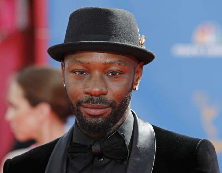 "Would Nelsan Ellis' feathered hat be considered ""jaunty""? Photo: Matt Sayles, AP"
