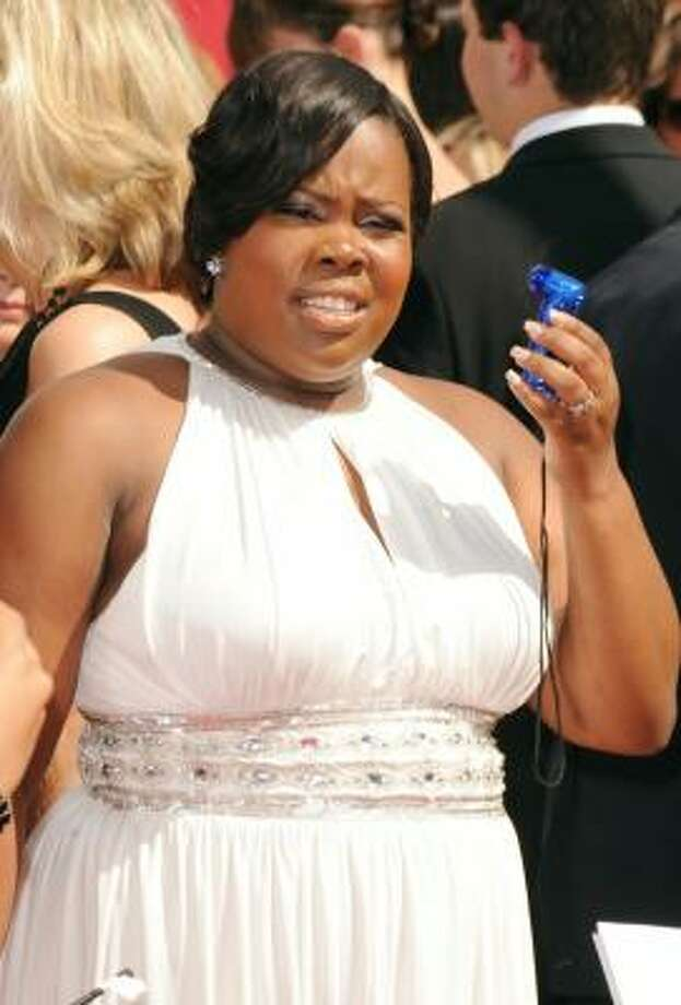 The ultimate accessory for a hot day - Amber Riley's hand-held fan. Photo: Jason Merritt, Getty Images