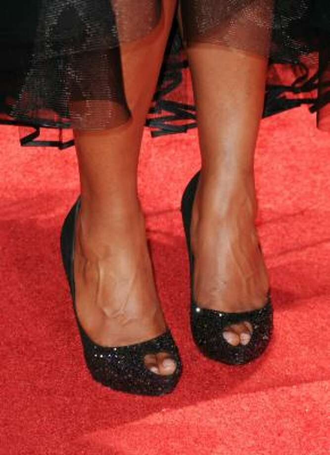 Mindy Kaling played peek a boo with her toes. Photo: Jason Merritt, Getty Images