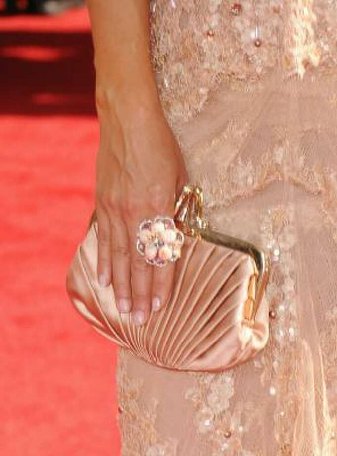 Jewel sported very few jewels - her pleated purse and matching flower ring. Photo: Jason Merritt, Getty Images
