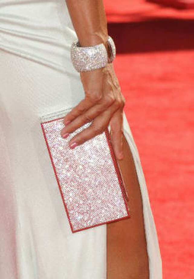 Eva La Rue's pink sparkly bag and bangle. Photo: Getty