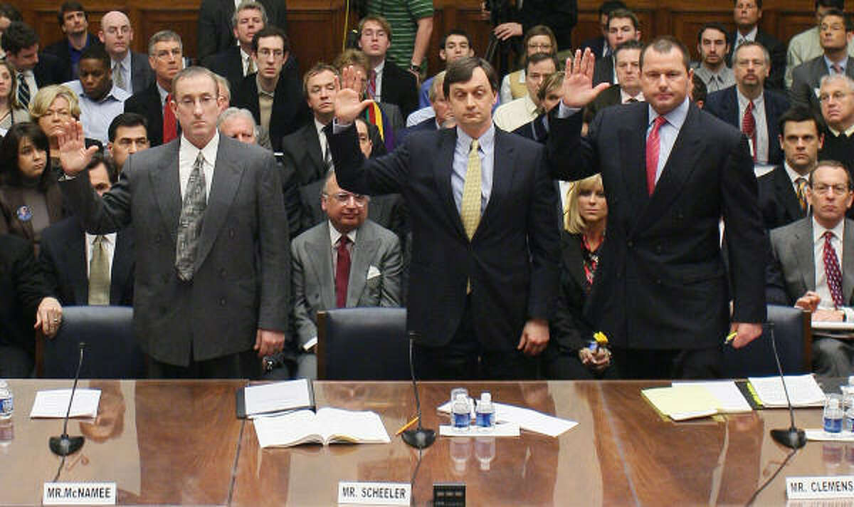 Feb. 13, 2008: From left, Brian McNamee, former personal trainer to Roger Clemens, Charlie Scheeler, member of the investigating staff for former Sen. George Mitchell's report, and pitcher Roger Clemens swear under oath before testifying.