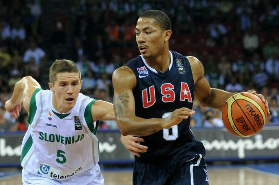 Aug. 29: USA 99, Croatia 77 Derrick Rose, right, goes to basket as Jaka Lakovic of Slovenia tries to catch him. Photo: MUSTAFA OZER, AFP/Getty Images