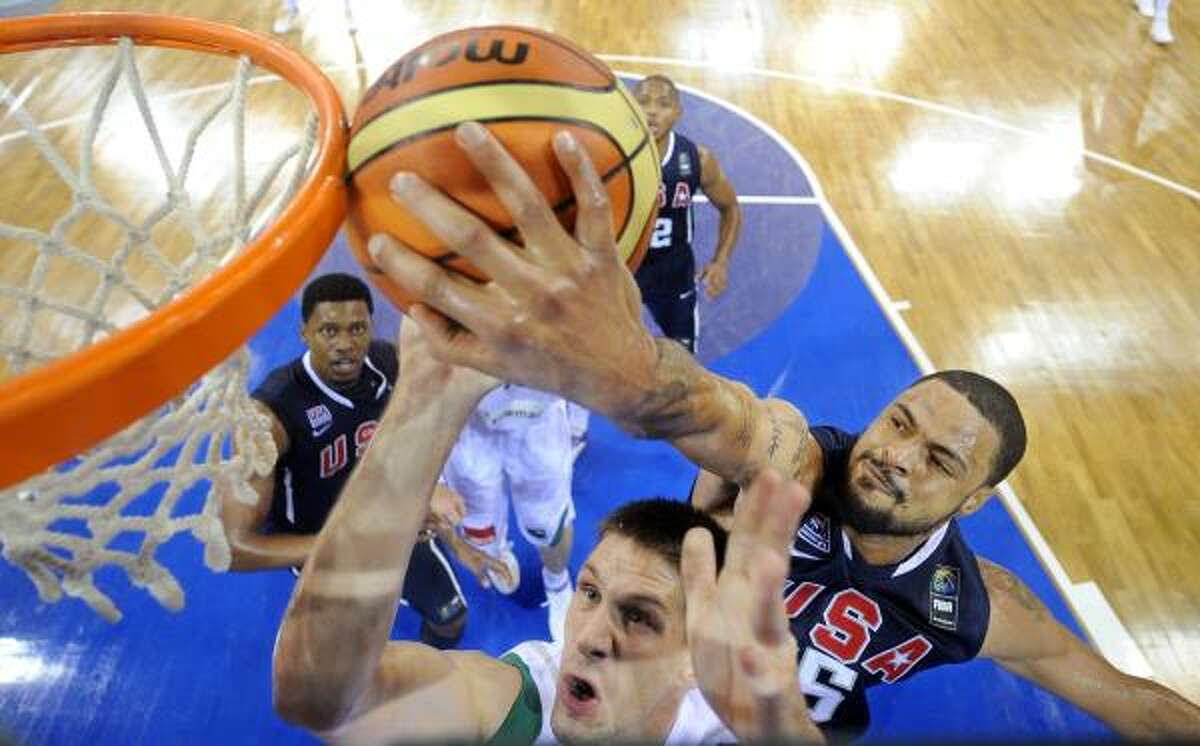 USA's Tyson Chandler, right, blocks the shot of Slovenia's Gasper Vidmar.