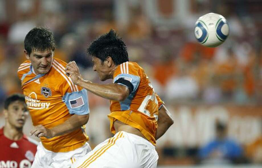 Dynamo forward Brian Ching, right, scores on a header in the 18th minute of Saturday's match against Toronto FC. Photo: Bob Levey, Getty Images