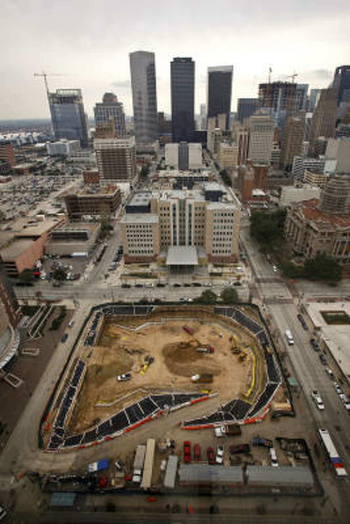 The construction site across from the Harris County Criminal Justice Center, 1201 Franklin, is representative of an ongoing trend, where surface parking lots are being replaced.