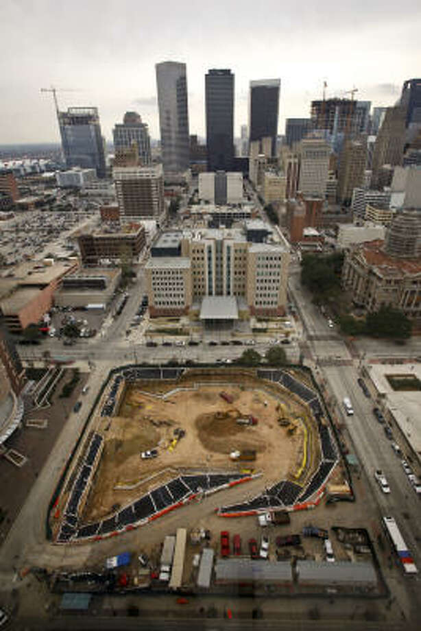 The construction site across from the Harris County Criminal Justice Center, 1201 Franklin, is representative of an ongoing trend, where surface parking lots are being replaced. Photo: Michael Paulsen, Chronicle