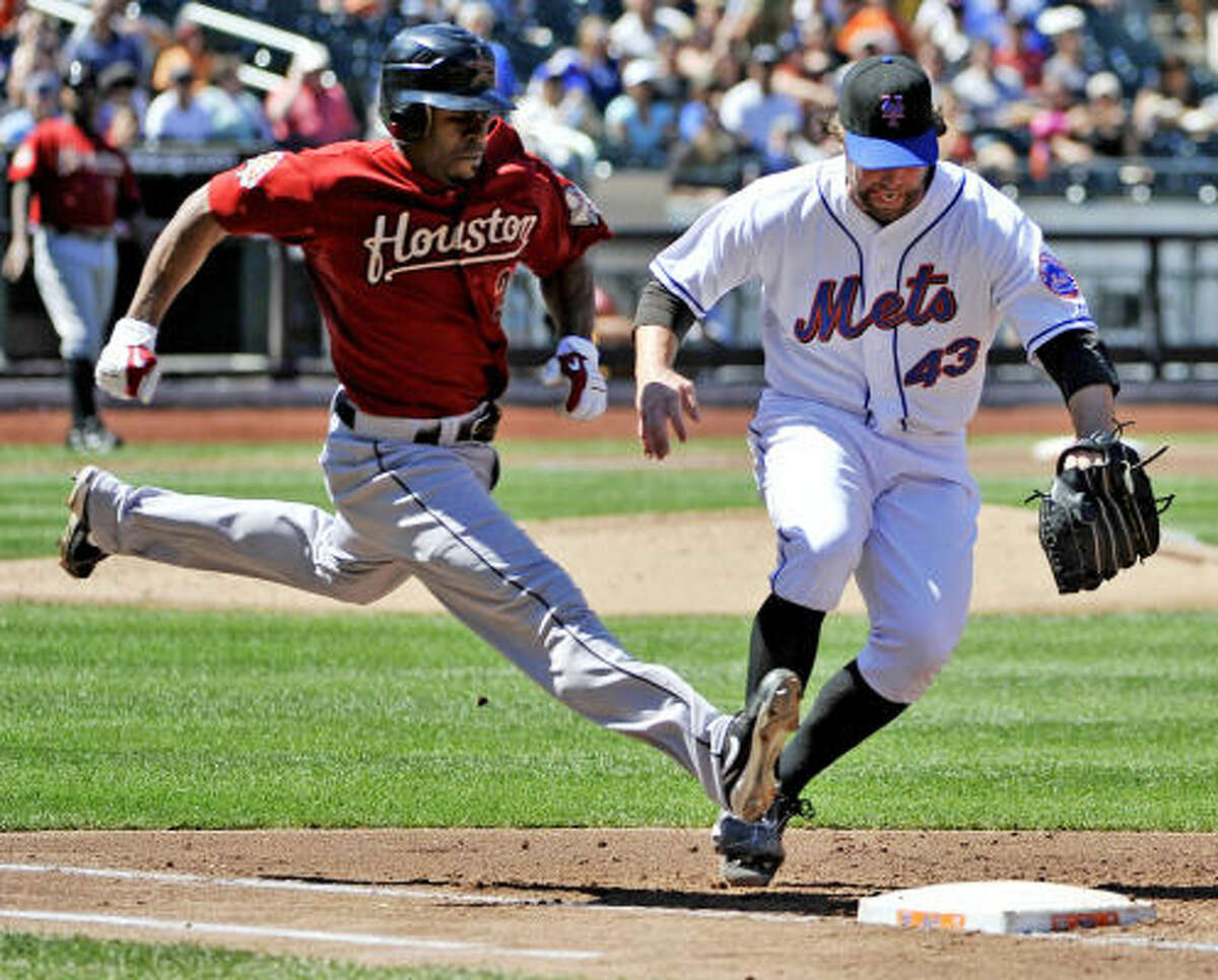 Aug. 29: Mets 5, Astros 1 Astros center fielder Michael Bourn beats Mets pitcher R.A. Dickey to first base in the third inning.
