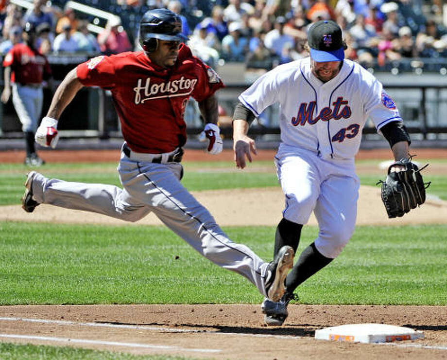 Aug. 29: Mets 5, Astros 1 Astros center fielder Michael Bourn beats Mets pitcher R.A. Dickey to first base in the third inning. Photo: Kathy Kmonicek, AP
