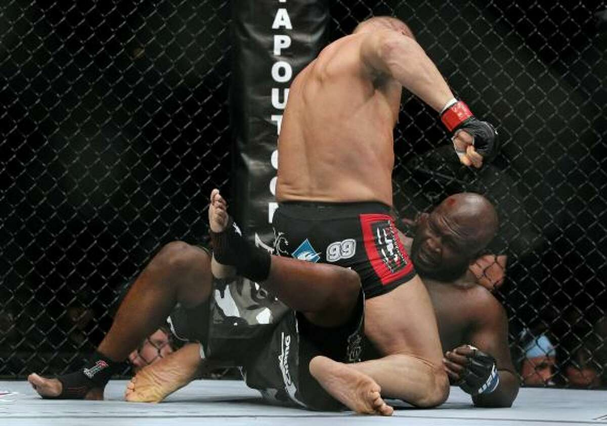 Randy Couture never let James Toney off the mat, landing punches to the head.