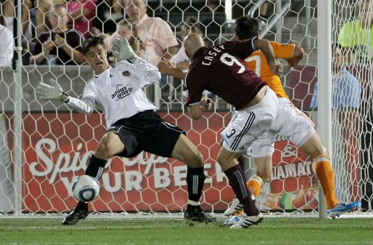 Dynamo goalkeeper Pat Onstad, left, manages to turn away this shot by Colorado's Conor Casey for a save during Saturday's match at Dick's Sporting Goods Park in Commerce City, Colo. The Rapids won Dynamo 3-0.