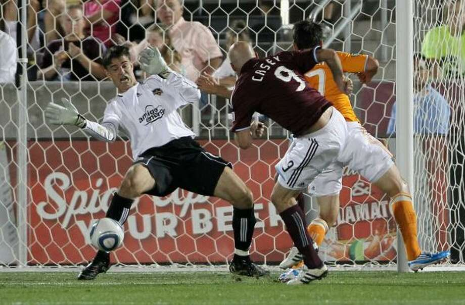 Dynamo goalkeeper Pat Onstad, left, manages to turn away this shot by Colorado's Conor Casey for a save during Saturday's match at Dick's Sporting Goods Park in Commerce City, Colo. The Rapids won Dynamo 3-0. Photo: Doug Pensinger, Getty Images