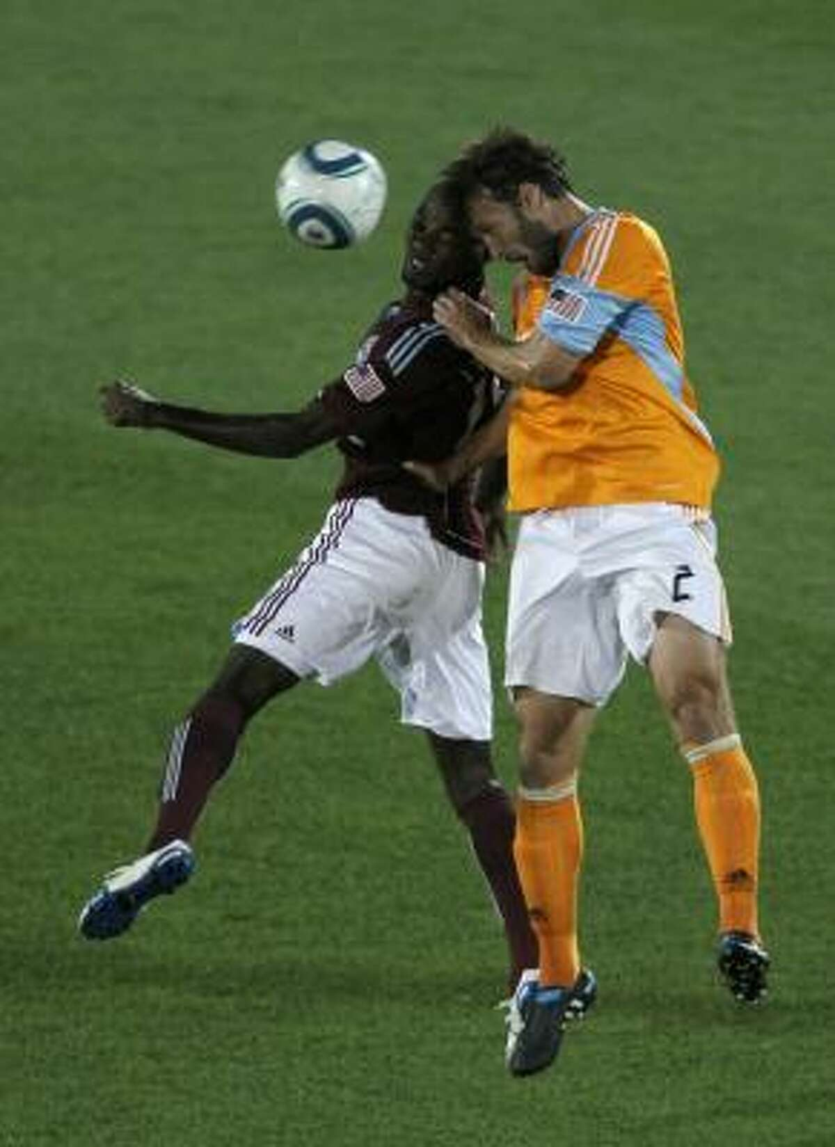 Colordao's Omar Cummings, left, and Dynamo defender Eddie Robinson battle for the ball.