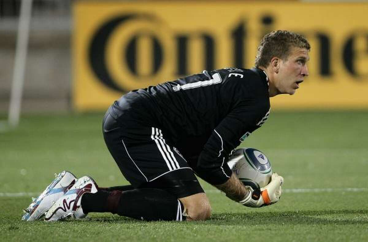 Rapids goalkeeper Ian Joyce collects the ball.