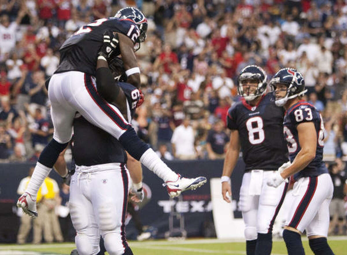 Texans 23, Cowboys 7 Texans wide receiver Jacoby Jones (12) celebrates his 24-yard touchdown reception during the first quarter.
